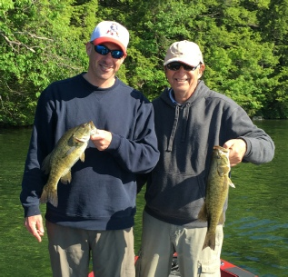 Fish NH Guide Service - father and son with a pair of nice bass