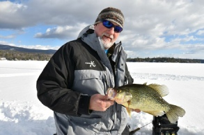 Fish NH Guide Service - Mark with a nice crappie caught through the ice