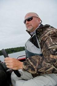 Fish NH Guide Service - Mark driving his boat