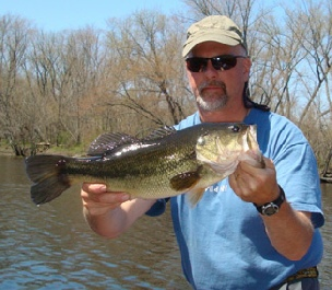 Fish NH Guide Service's Mark Beauchesne with a nice largemouth bass